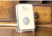 This uncirculated 10p has been struck by The Royal Mint to celebrate Great Britain. It features the letter 'X' and represents X marks the spot. This 10p comes protectively encapsulated.