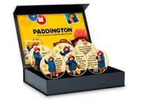 The Official Paddington Commemorative Set contains 6 Paddington commemoratives in a Deluxe Presentation Box. Plated with 24 carat gold and struck to a Proof finish. Obverse: official Paddington Logo.