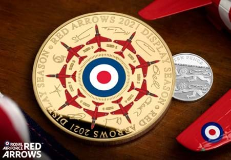 Image of Red Arrows Signature Gold-Plated Commemorative next to a UK 10 pence coin