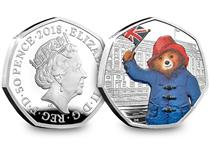 This UK 2018 Silver Proof Paddington Bear at Buckingham Palace coin has been issued to celebrate the 60th anniversary of Paddington Bear. The reverse design features Paddington wearing his outfit.