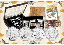 Boxed Collection of Royal Mail's three Peter Rabbit stamps from 1979, 1993 and 1994 abd The Royal Mint's four 2018 50p coins. All items come in a Deluxe Presentation Case. EL: 750.