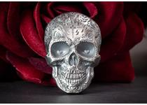 This Silver 1oz coin is in the shape of a skull and intricately engraved with typical Mexican Day of the Dead calavera designs. Detailed with impressive high relief using smartminting technology.