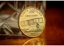 US Gold-Plated Quarter issued in North Carolina with Philadelphia mintmark. Commemorates the Wright Brothers successful flight on December 17th, 1903. It is double-plated with 24-Carat Gold.