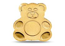 This coin has been struck from .9999 gold in the shape of a Teddy Bear.
