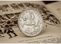 The 1935 George V Crown struck by the Royal Mint in Silver. Obverse of the crown features the George and Dragon design. Supplied with certificate of authenticity