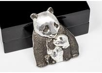This lucky fine silver coin has been struck in the shape of a baby Giant Panda playing with its mother, with an antiqued finish and incredible high relief achieved with smartminting technology.