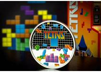 This coin has been issued to celebrate the 35th Anniversary of Tetris.It features the icon Tetriminos on a chequered, proof backround, and appears as if the blocks are falling.