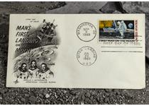 The original USA 1969 Moon Landing FDC, postmarked on the date the first man, Neil Armstrong, walked on the moon. The master die used to create the stamp travelled to the Moon on board Apollo 11.