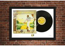 Limited Edition A2 Presentation Frame comprising a pristine, unplayed Goodbye Yellow Brick Road vinyl album and Royal Mail's 2019 stamp. Professionally framed and ready to hang. Edition Limit: 250.