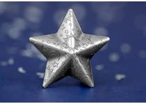This 5 dollar coin for Palau is minted from 999/1000 silver in the shape of a star. It features engraved detail of moons and stars and is finished with an antique-finish.