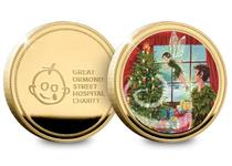 24 Carat Gold-Plated Peter Pan Christmas Commemorative featuring a colour image of Peter Pan and Tinker Bell decorating a Christmas Tree. 10% GOSH donation. Presented in a Christmas card. EL. 2019