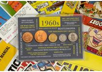 includes circulating 1960s coins presented in an 60's themed frame. It includes a Half penny, penny, threepence, sixpence, and a shilling. Also comes with a replica 1960s memorabilia pack.