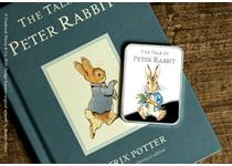 The Official Peter Rabbit™ Commemorative features a full colour image of a mischievous young Peter Rabbit. The obverse features the Peter Rabbit logo.