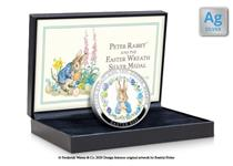 The Peter Rabbit Easter 2020 commemorative features a colour illustration of Peter Rabbit in an Easter Wreath. It's presented in a box. Edition limit: 995. Struck from .925 Silver. Finish: Proof