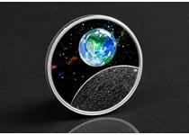 This coin has been struck by The Royal Canadian Mint from 99.99% Silver to a Proof finish. It features a design of the Earth that is made from recycled glass. It also features blacklight technology.