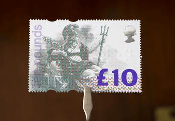 £10 Britannia Stamp with tweezers